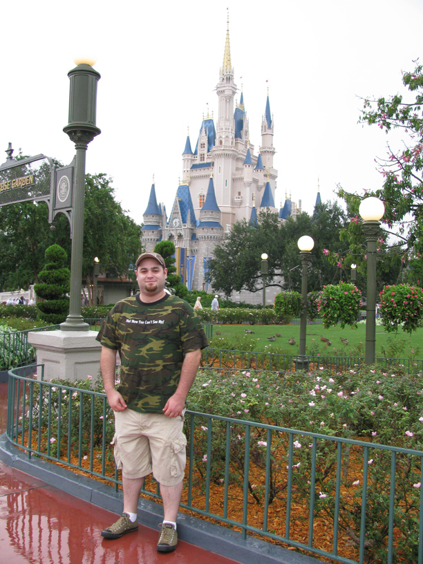 Jesse in front of Cinderella's castle.